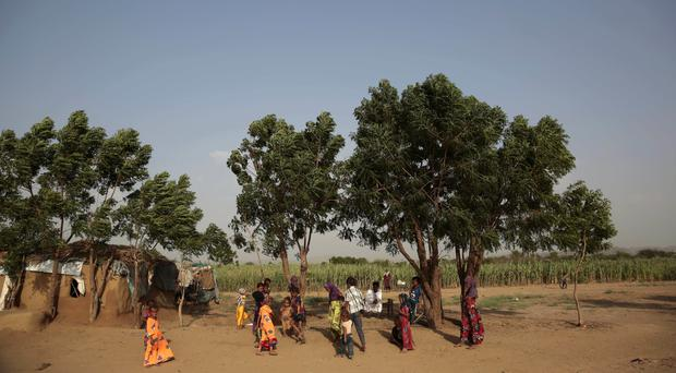 Girls play at a camp for internally displaced people, near the town of Abs, on Yemen's western coastal plain (AP)