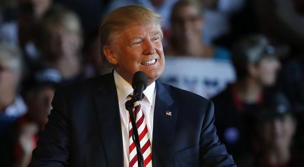 Republican presidential candidate Donald Trump's all smiles at a campaign rally in Colorado, but several polls show he is trailing Hillary Clinton (AP)