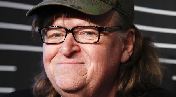 Michael Moore In TrumpLand features a one-man stage show of Moore discussing the presidential race (Andy Kropa/Invision/AP)