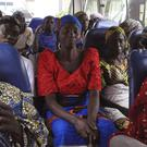 Family members of the kidnapped girls depart to meet the Nigerian minister of women affairs in Abuja (AP)