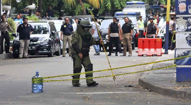 A police bomb squad specialist inspects the site in Tangerang, Indonesia (AP)
