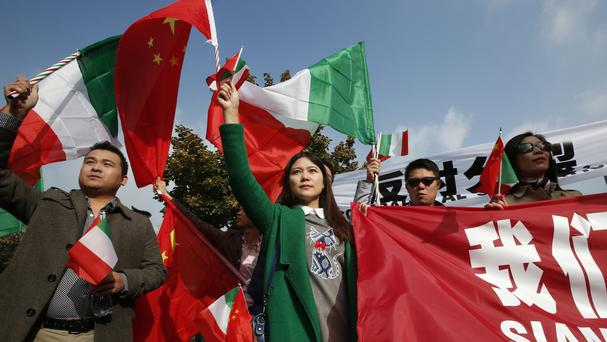 Chinese protesters demonstrate outside the University of Milan-Bicocca where the Dalai Lama will be made honorary citizen (AP)