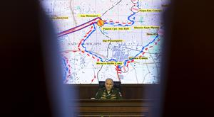 Russian Lieutenant General Sergei Rudskoi at a briefing before a 'humanitarian pause' in attacks on the Syrian city of Aleppo (AP)