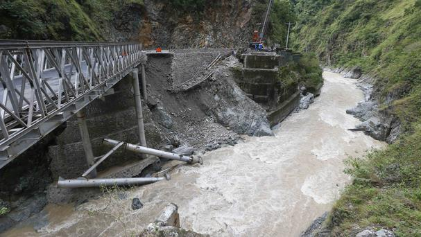A damaged bridge linking the summer capital of Baguio city in northern Philippines to Manila (AP)