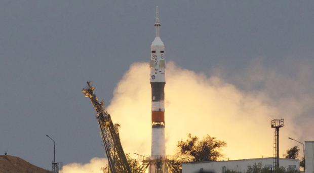 The Soyuz rocket booster blasted off from Baikonur cosmodrome in Kazakhstan on Wednesday (AP)