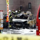 Firefighters investigate the scene in Utsunomiya (Yukie Nishizawa/Kyodo News via AP)