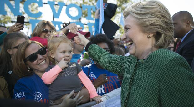 Hillary Clinton greets supporters in Raleigh, North Carolina (AP)