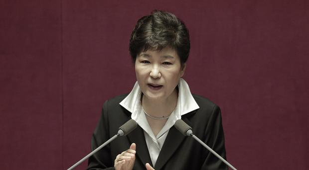 South Korean president Park Geun-hye delivers a speech at the National Assembly in Seoul (AP)