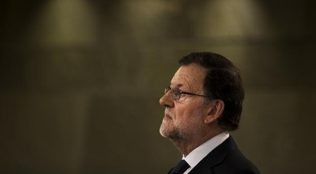 Mr Rajoy should form a government at the weekend, ending months of uncertainty in Spain (AP)
