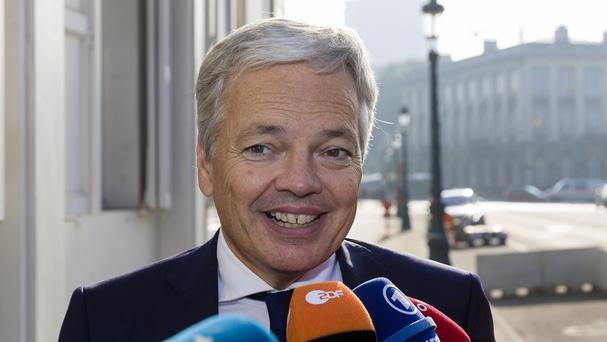Didier Reynders speaks with the media during a break in a meeting at the Belgium Prime Minister's residence in Brussels (AP)
