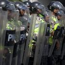 Police block an opposition march against Venezuela's President Nicolas Maduro in Caracas (AP)