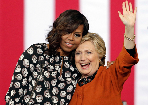 Democratic presidential candidate Hillary Clinton is hugged by first lady Michelle Obama during a campaign rally in Winston-Salem, North Carolina
