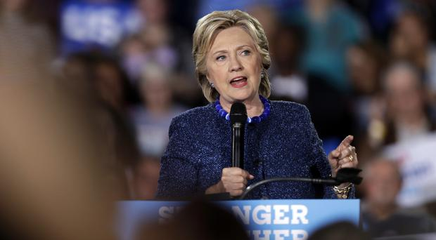 Hillary Clinton, speaking at a rally in Des Moines, Iowa, has been hit by a new FBI emails probe (AP)