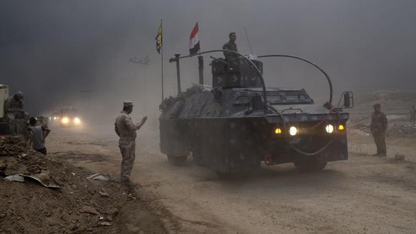 An Iraqi Federal Police at a checkpoint in Qayara, some 30 miles south of Mosul (AP)
