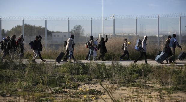 Thousands of migrants have been moved from the Calais camp (AP)