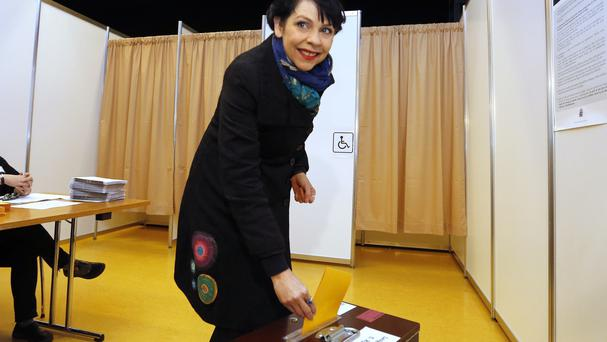 Birgitta Jonsdottir of the Pirate Party casts her vote at a polling station in Reykjavik, Iceland (AP)