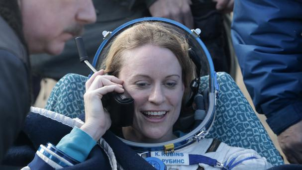 US astronaut Kate Rubins calls her relatives shortly after the landing of the Russian Soyuz MS space capsule (AP)