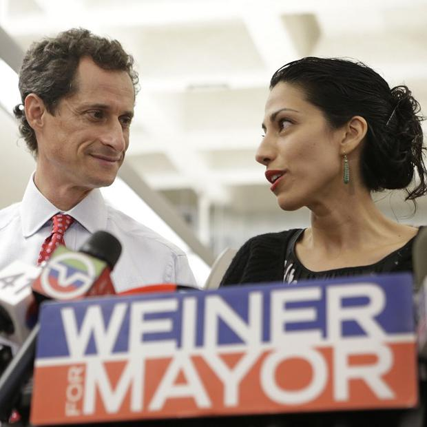 Anthony Weiner, pictured with his wife and Clinton aide Huma Abedin. Weiner split from his wife in April
