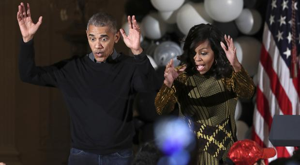 Politics can be scary - Barack and Michelle Obama dance to the beat of Michael Jackson's Thriller at a White House Halloween celebration (AP)