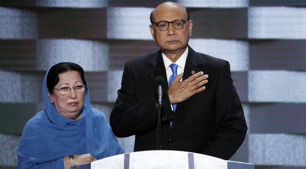 Khizr and Ghazala Khan, the parents of fallen US Army captain Humayun Khan, take the stage at the Democratic National Convention in Philadelphia in July (AP)