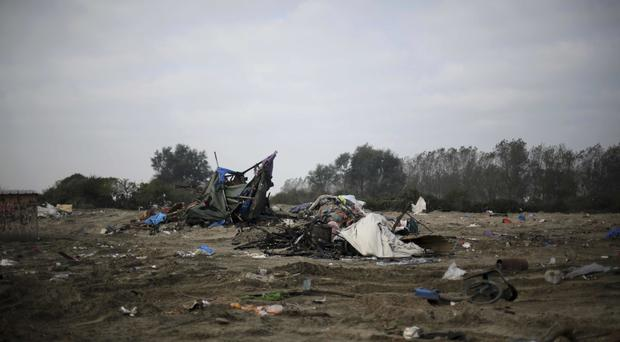 Remains of the Jungle migrant camp near Calais in northern France (AP)