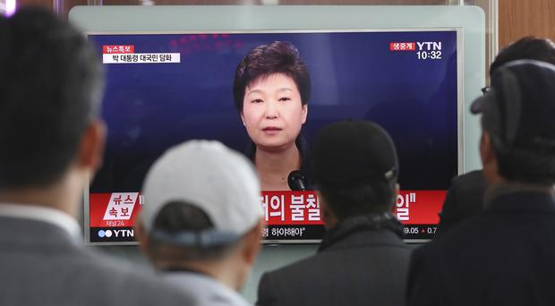 South Koreans watch President Park Geun-hye's live address to the nation (AP)