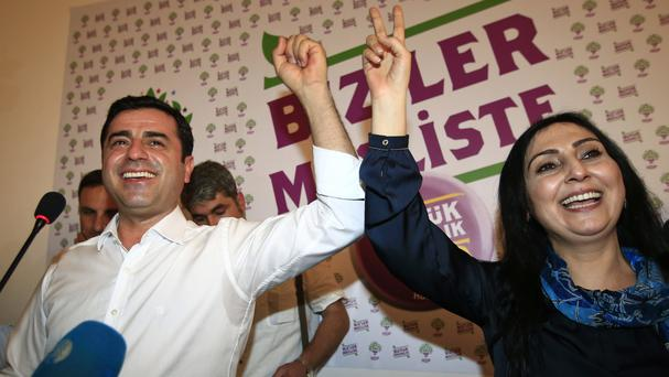 Selahattin Demirtas, left, and Figen Yuksekdag celebrate their party's election success last year (AP)