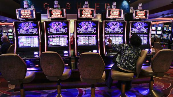 A gambler plays the slots at a casino (AP)