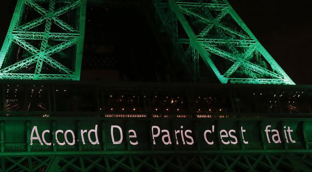 The Eiffel Tower lit up in green to mark the Paris Agreement (AP)