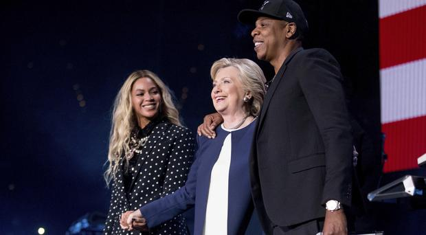 Hillary Clinton on stage with Jay Z and Beyonce during the free concert at the Wolstein Centre in Cleveland, Ohio (AP)