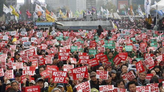 South Korean protesters stage a rally calling for President Park Geun-hye to step down