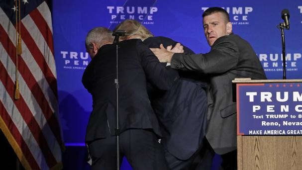 Secret Service agents rush Republican presidential candidate Donald Trump off the stage at the rally in Reno (AP)