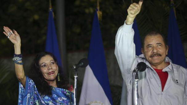 Nicaragua's president Daniel Ortega and his wife Rosario Murillo hail supporters after casting their ballots (AP)