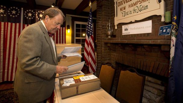 Tom Tillitson arrives with ballots as voters in Dixville Notch get ready to cast their votes at midnight (AP)