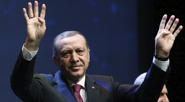 Turkish President Recep Tayyip Erdogan has been warned he will only have himself to blame if the EU does not grant visa-free travel in Europe to Turkish citizens. (AP)