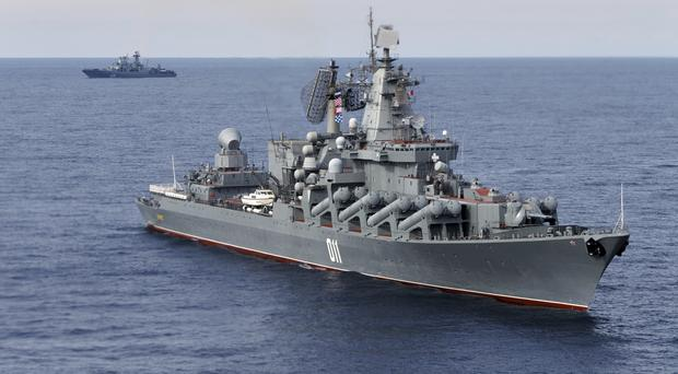 The Russian missile cruiser Varyag, with the Russian navy destroyer Vice Admiral Kulakov in the rear, on patrol in the Mediterranean. (AP)