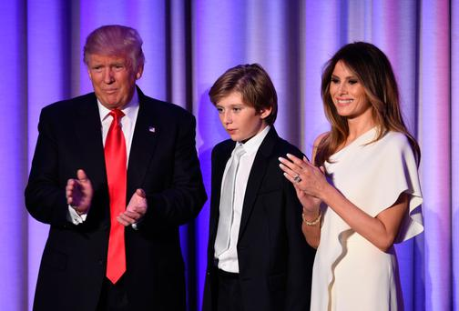 Donald Trump with his son Barron and wife Melania yesterdayises