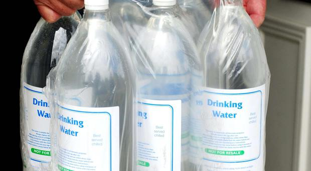 A judge said the state of Michigan and Flint must provide each home with four cases of bottled water per week per resident, if they qualify
