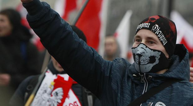 Nationalists, carrying Polish flags, march through the streets of Warsaw. (AP)