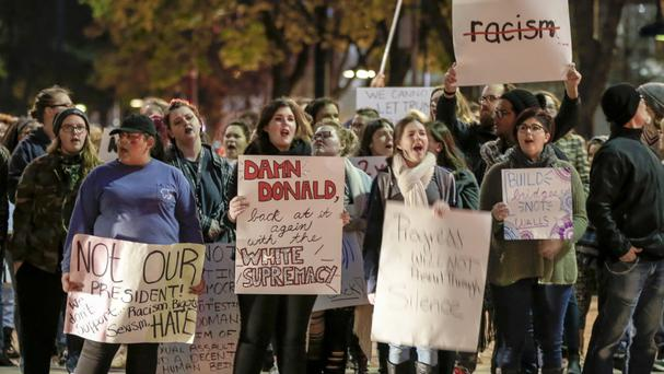 Demonstrators at a protest in Omaha, Nebraska, against the election of Donald Trump as President (AP)
