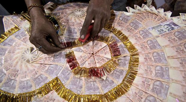 The Indian government's declaration that the bulk of Indian currency notes no longer hold any value has led to chaotic scenes (AP)