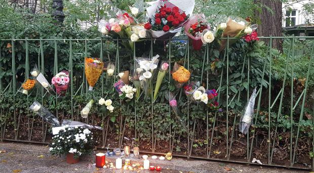 Candles and flowers opposite the Bataclan concert hall in Paris as the city prepares to mark one year since the terrorist attacks