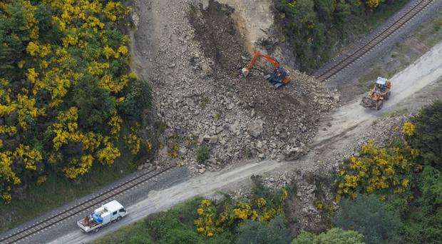 A rail line is covered by landslide near Conway in Kaikoura, New Zealand, after a powerful earthquake (SNPA/AP)