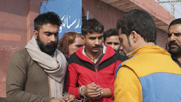 People allegedly involved in the flogging of a transgender person arrive at a court in Sialkot, Pakistan (AP)