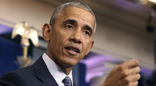 Barack Obama tried to soothe any fears about the security direction Donald Trump wants to take the US (AP)
