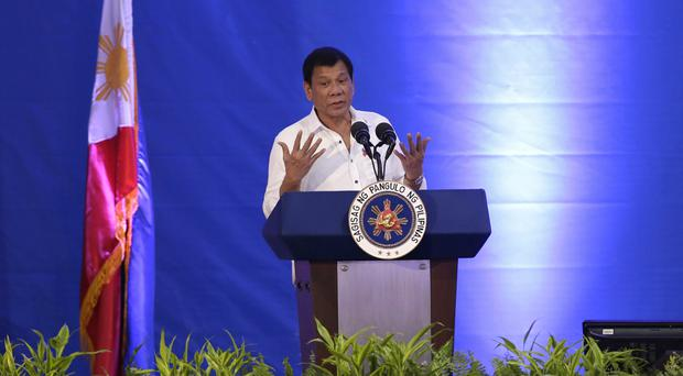 Philippines President Rodrigo Duterte delivers a speech in Manila (AP)