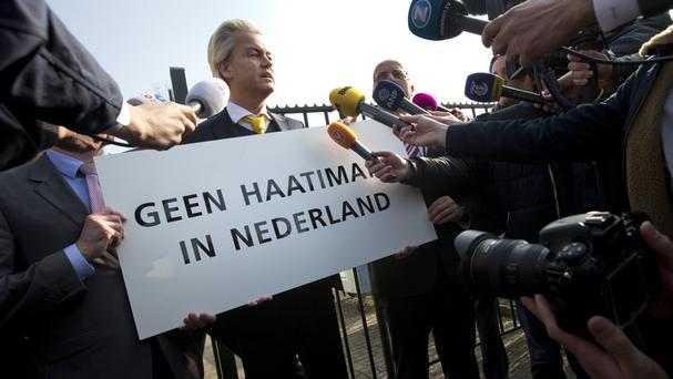 Geert Wilders, leader of the anti-Islam Freedom Party, holds a sign reading 'No Hate Imams in the Netherlands' (AP)