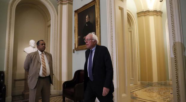 Mr Sanders said the Breitbart chief's appointment was 'totally unacceptable'