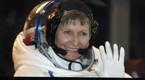 US astronaut Peggy Whitson gestures from a bus prior the launch of the Soyuz MS-3 space ship at the Baikonur cosmodrome, Kazakhstan (AP)