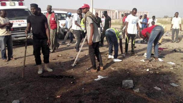 People clear the scene after an explosion in Maiduguri, Nigeria (AP)